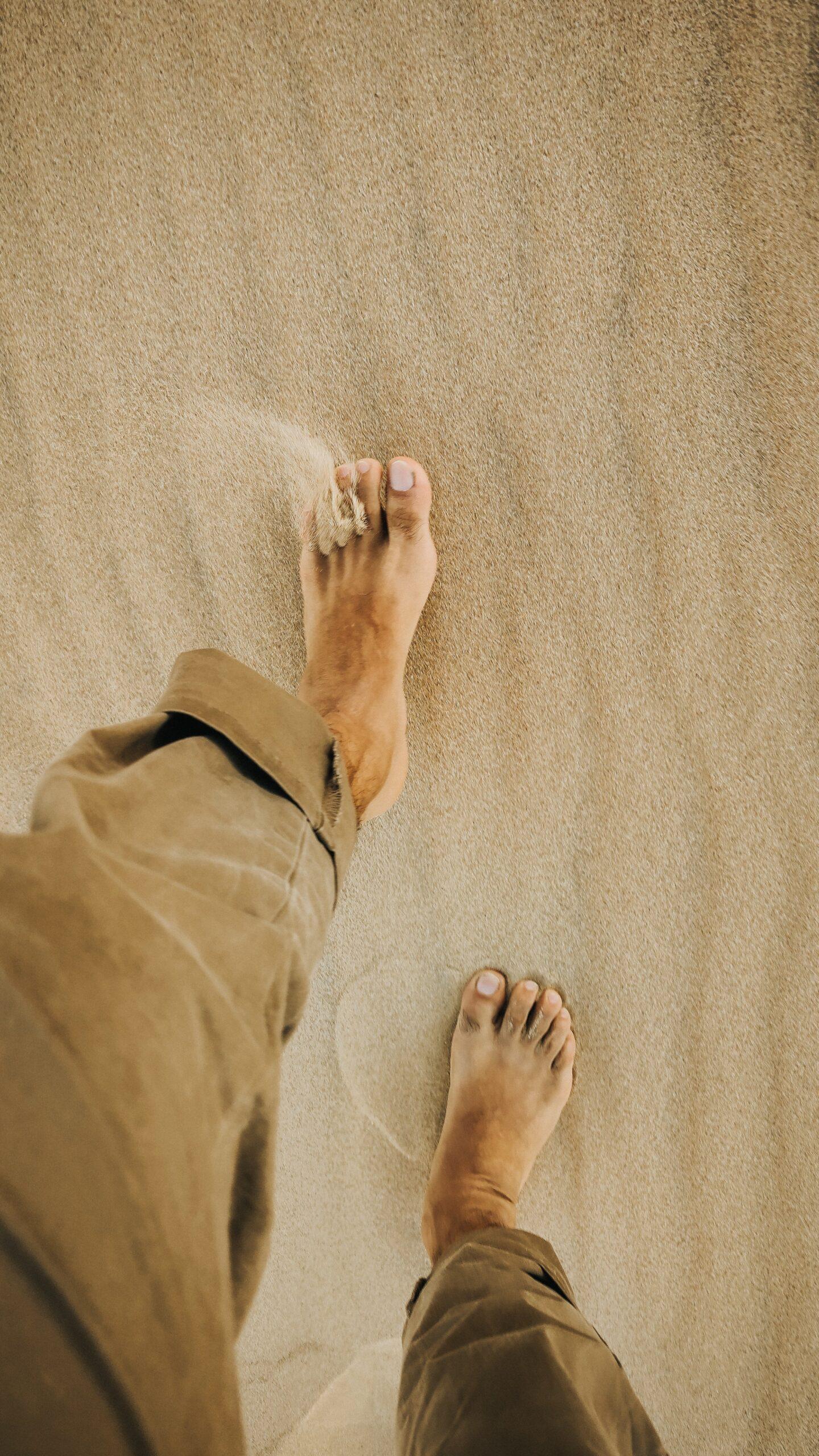 Man walking in sand