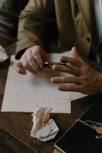 Man with paper and pen