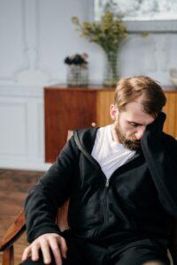 Sad man sitting in a chair