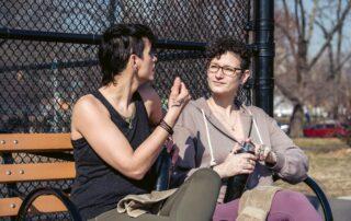 Friends talking in park
