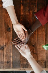 Hands joined together in support