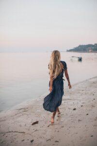 Blonde woman walking on beach