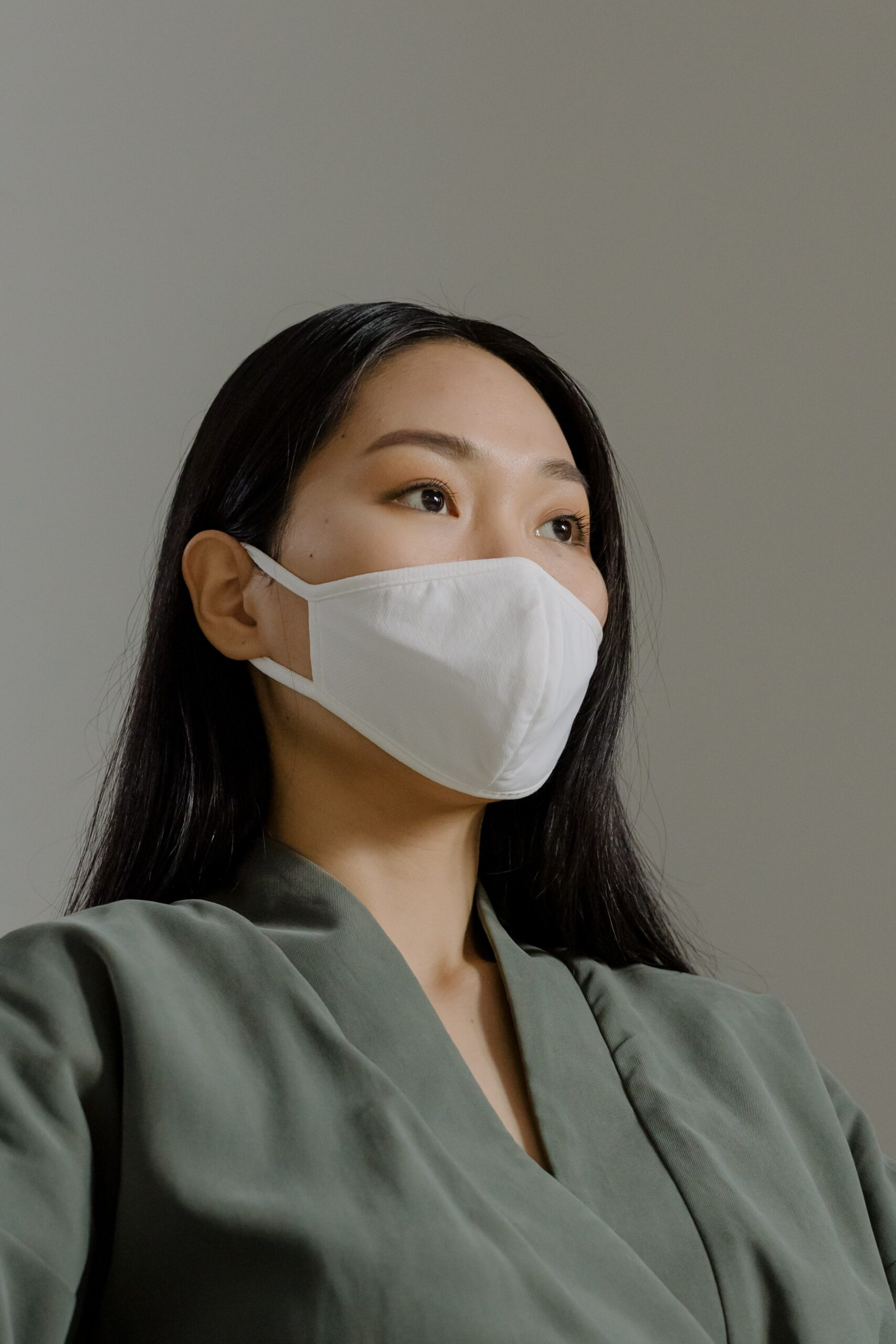 Woman in suit wearing a mask