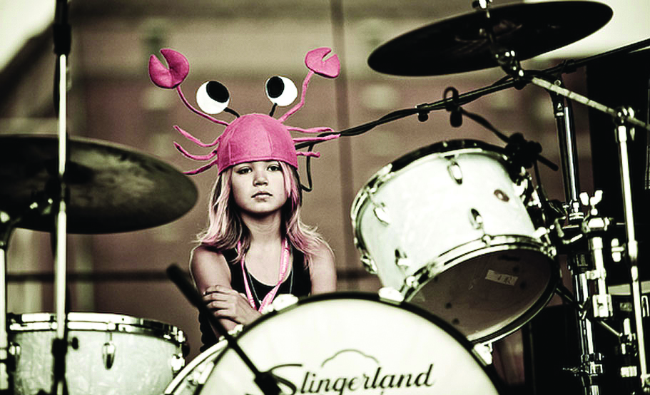 Girl at drum set with sassy hat