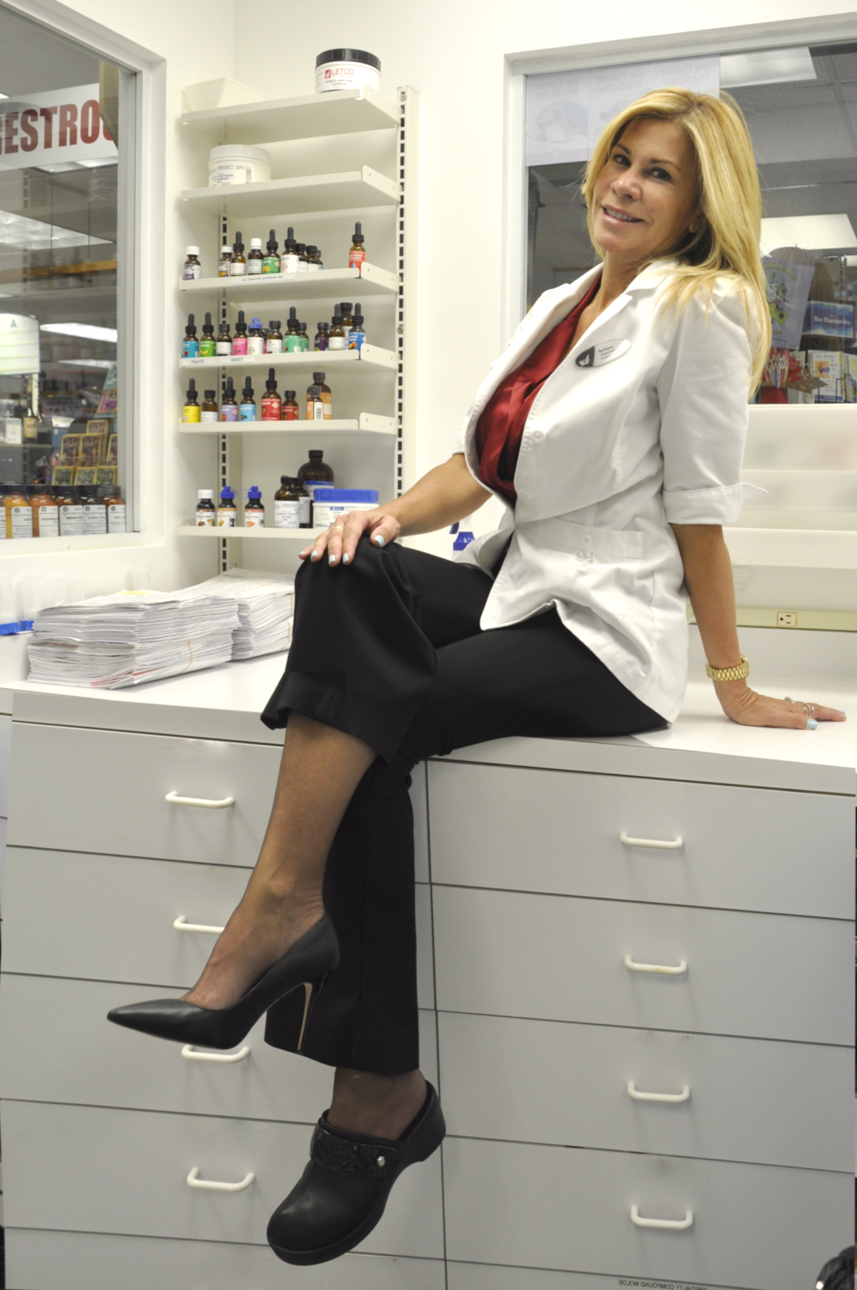 Pharmacist sitting on counter