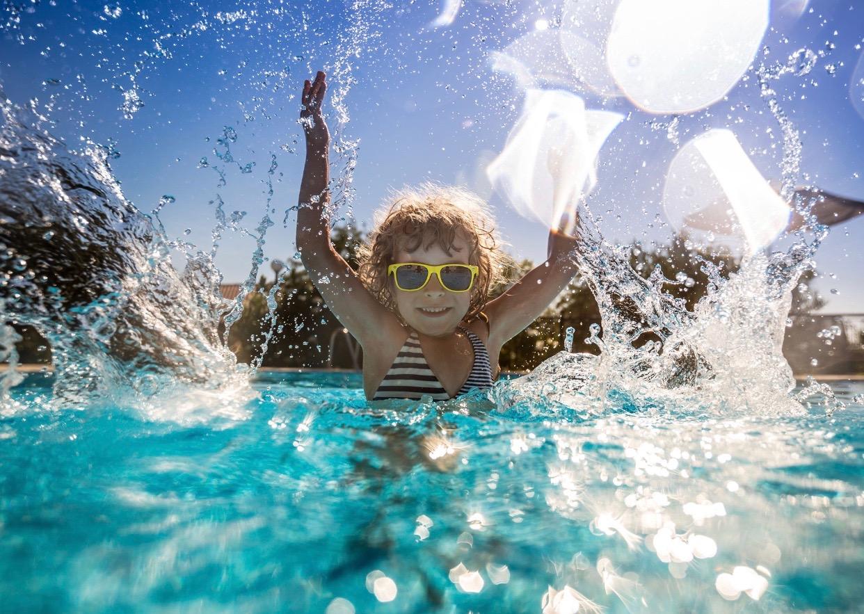Girl Splashing in pool