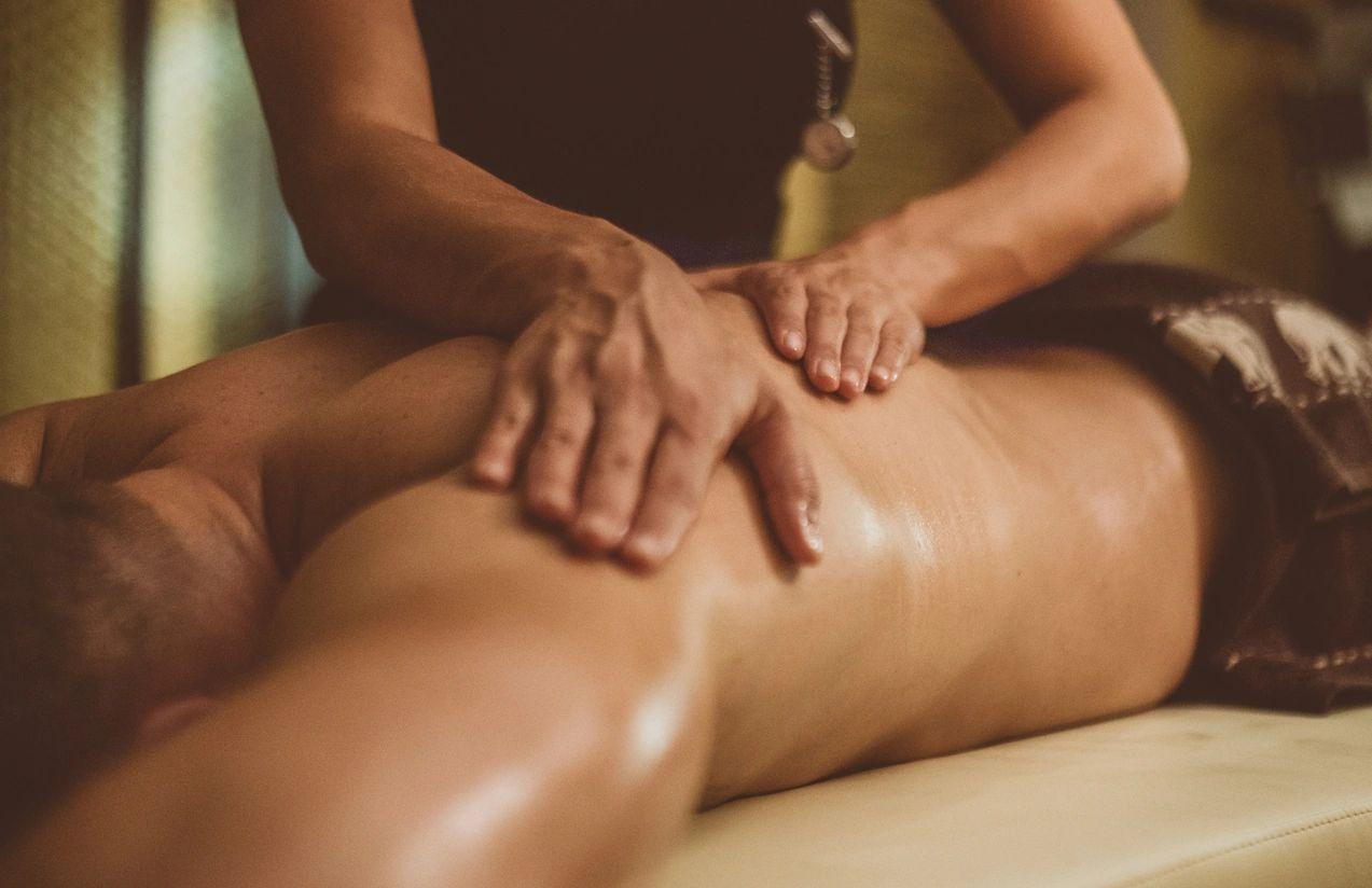 Hands massaging client's back
