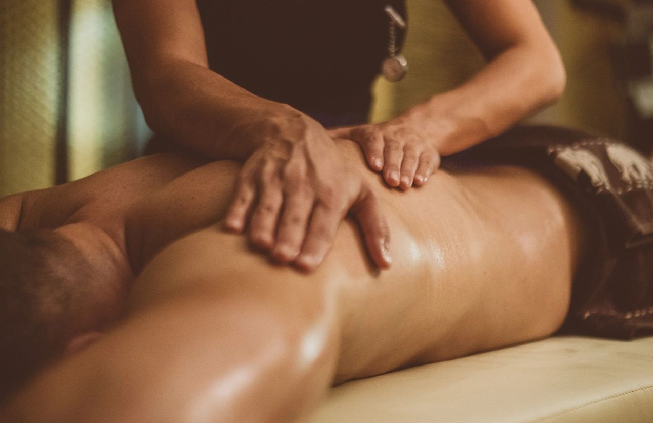 Hands massaging client's back