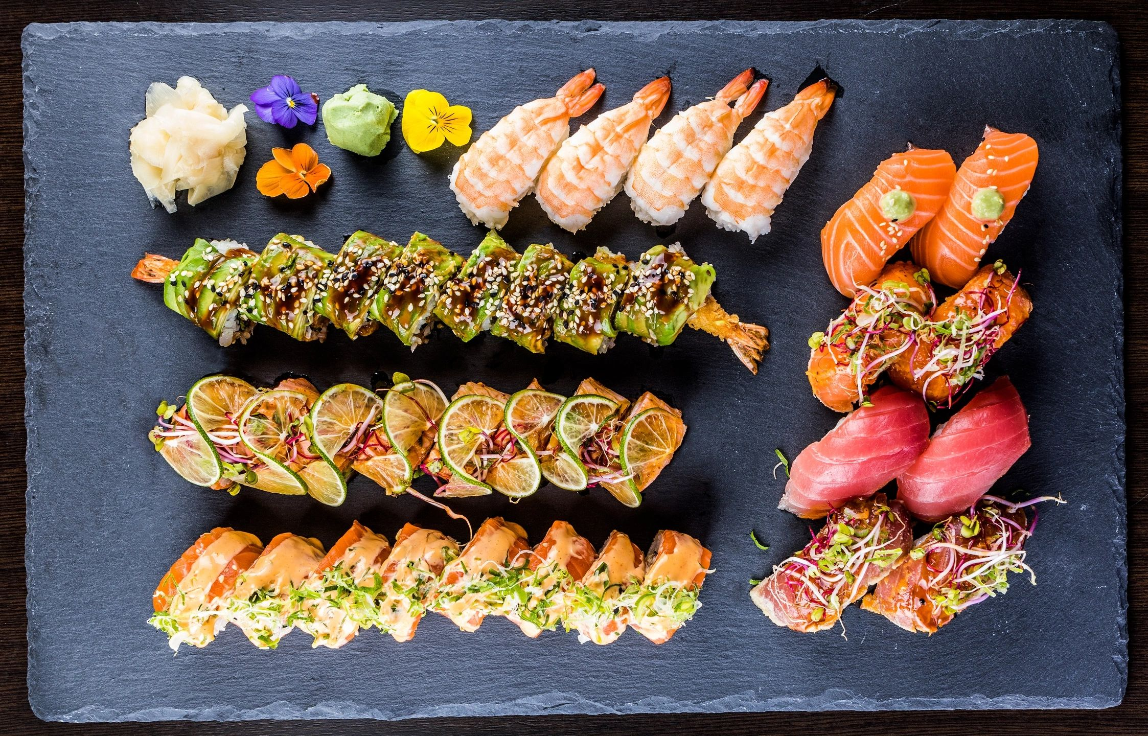 Platter with various types and pieces of sushi