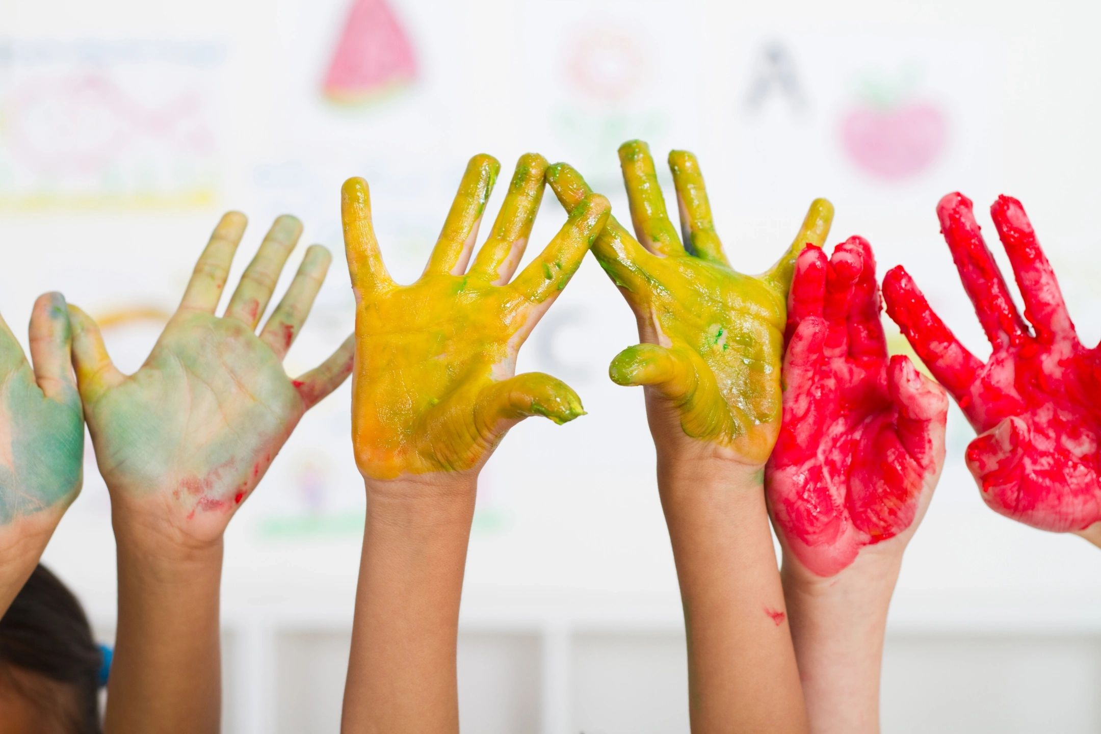 paint covered children's hands