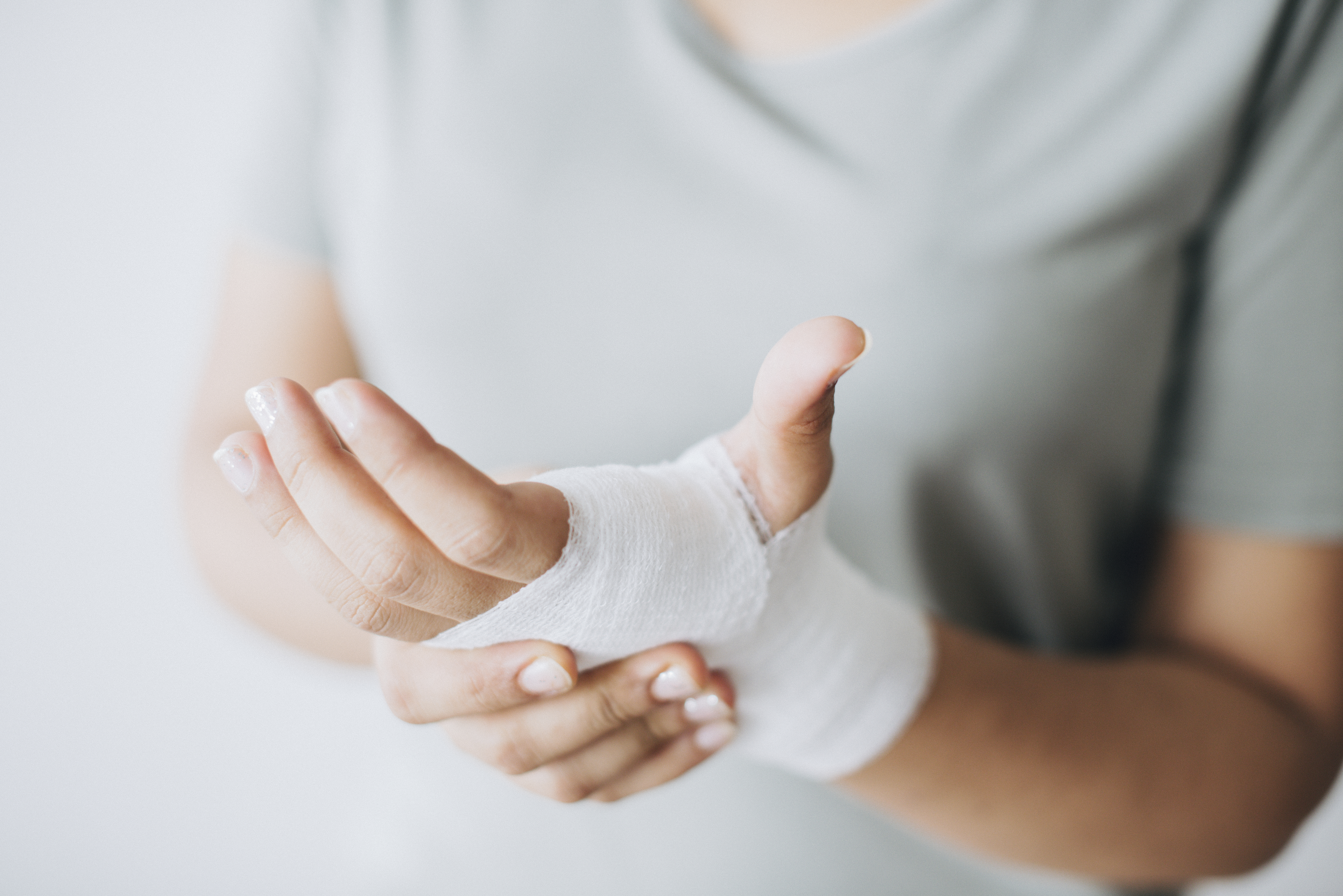 hands rubbing injured wrist
