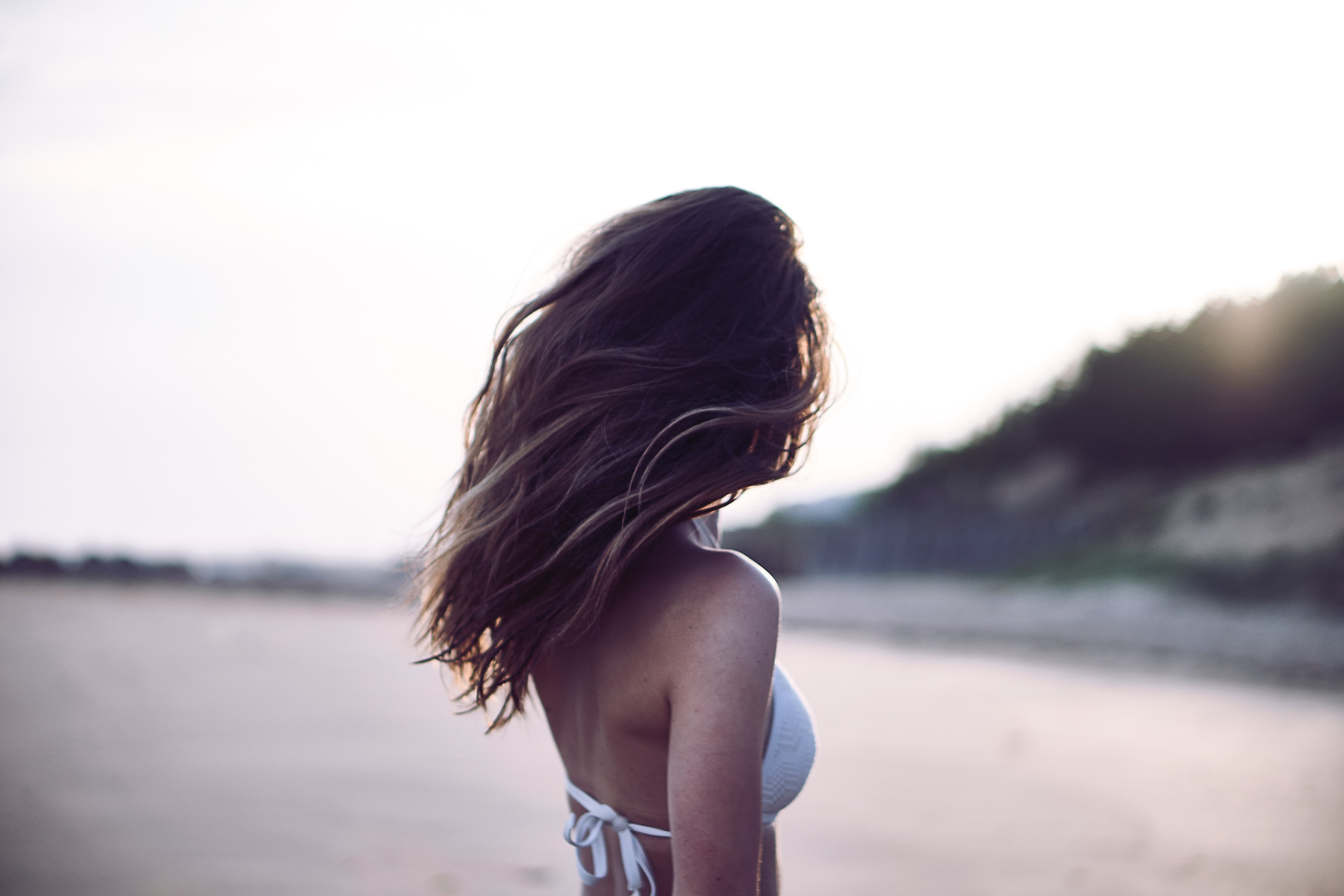 woman with full head of hair on beach