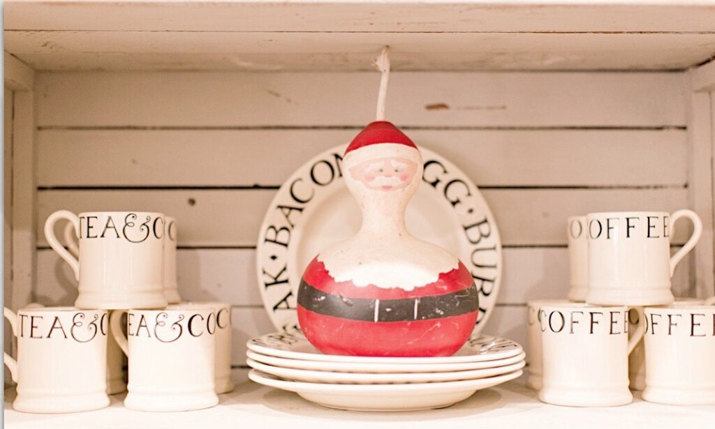 a collection of Emma Bridgewater Black Toast dishes topped with a santa that my mom made from a gourd.
