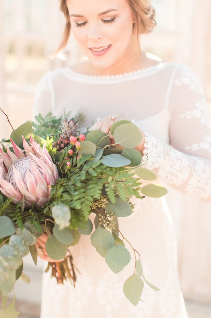 brides bouquet with a huge protea in the center