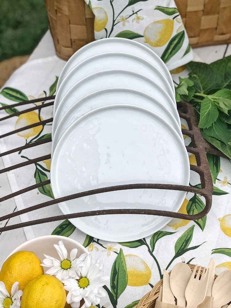 white plates standing in a vintage hay fork