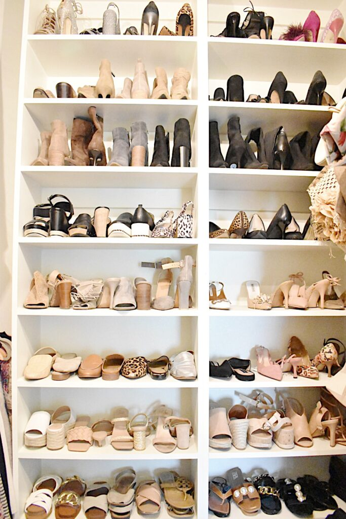 neatly organized shoe closet organized by color