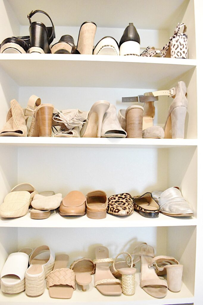 neutral color shoes on shelves in closet