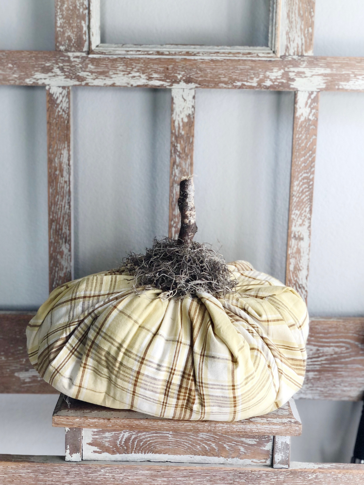 plaid fabric pumpkin with real stick for stem