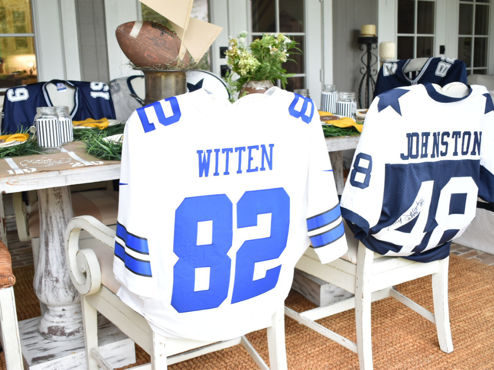 football jerseys over the back of chairs for slipcovers to go with my football themed tablescape