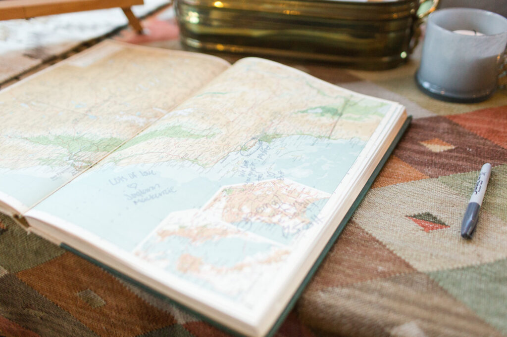 a large world atlas book used for guest book