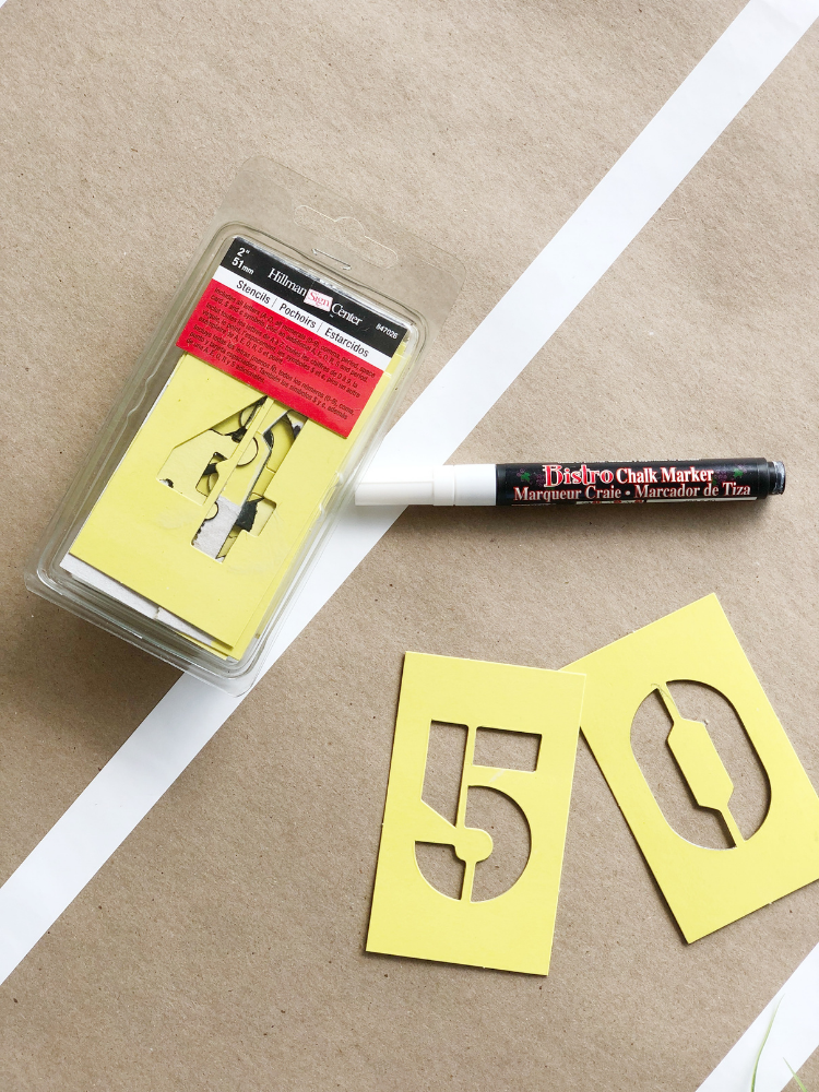 white chalk pen and number stencils - supplies to create yard line numbers for a football themed table runner