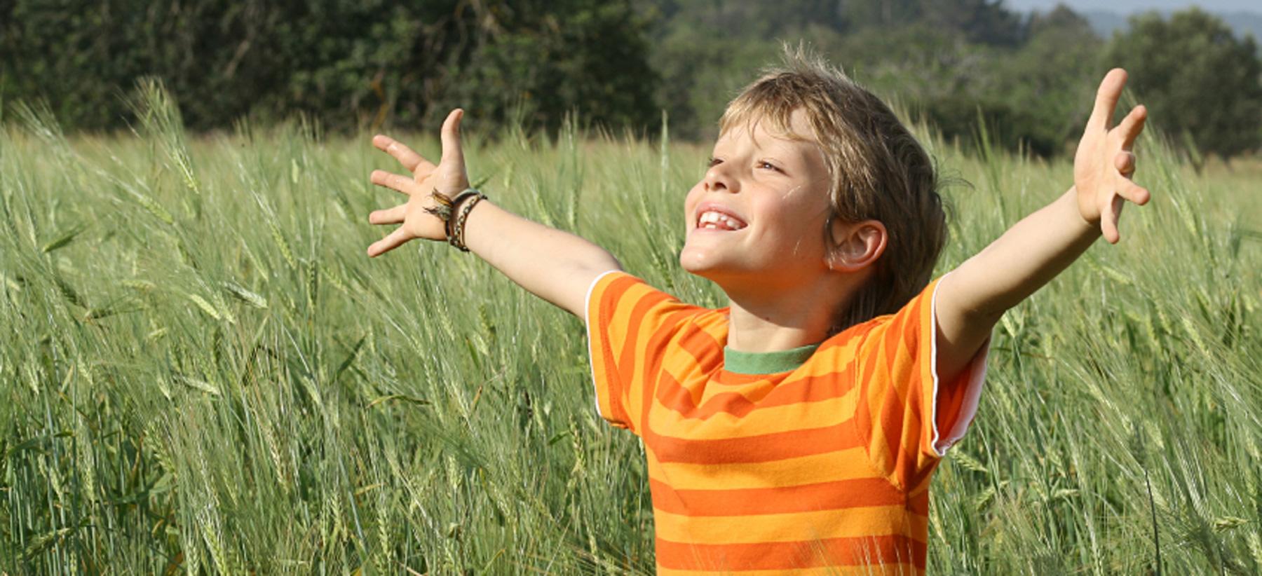 Child in field at Montessori Children's School of Northfield