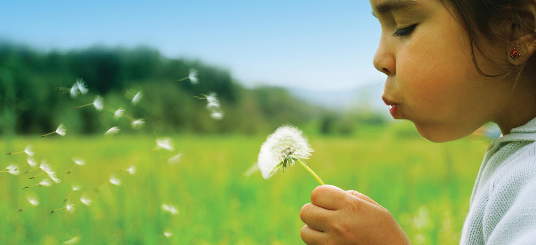 Girl with flowers at Montessori Children's School of Northfield