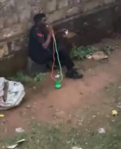 """Captured image from viral video showing a man seemingly wearing a Nigeria Police Uniform vapping """"Shisa"""""""