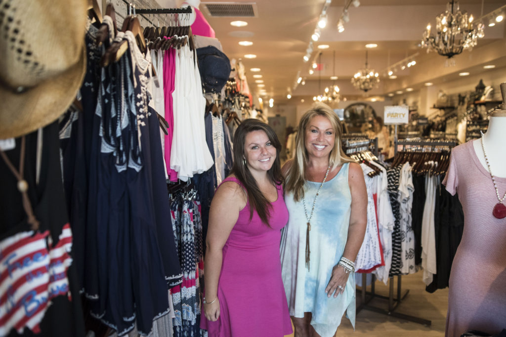 Ginger O'Connor and her daughter, Melanie, left, opened Apricot Lane Boutique in St. Armand's Circle.  STAFF PHOTO / NICK ADAMS