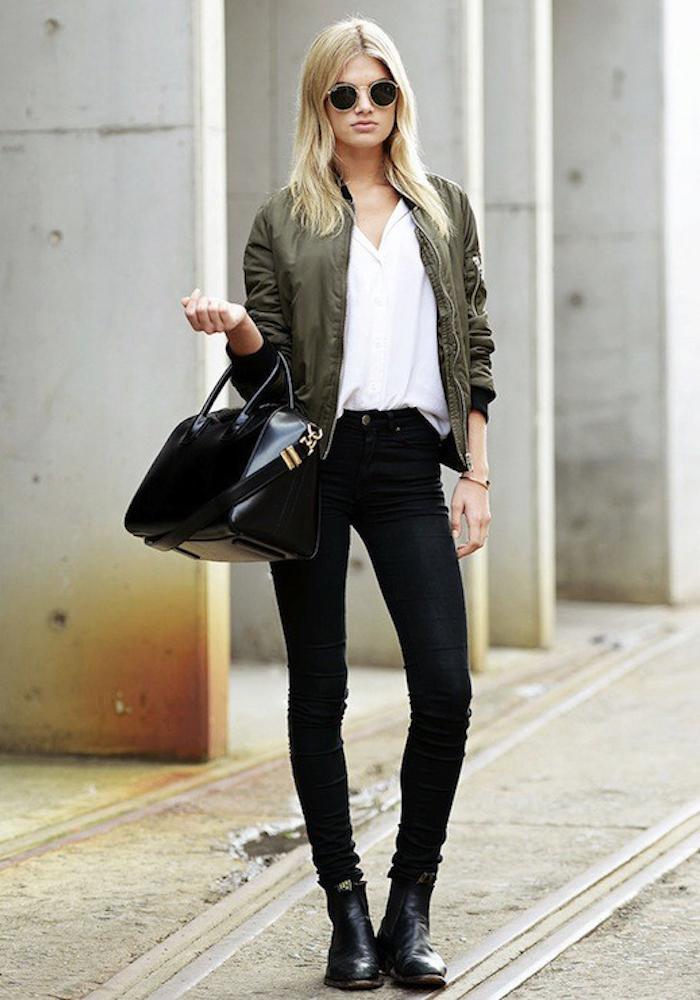 le-fashion-blog-model-off-duty-style-megan-irwin-ray-ban-round-sunglasses-green-bomber-jacket-givenchy-bag-black-jeans-boots-via-carolines-mode-1