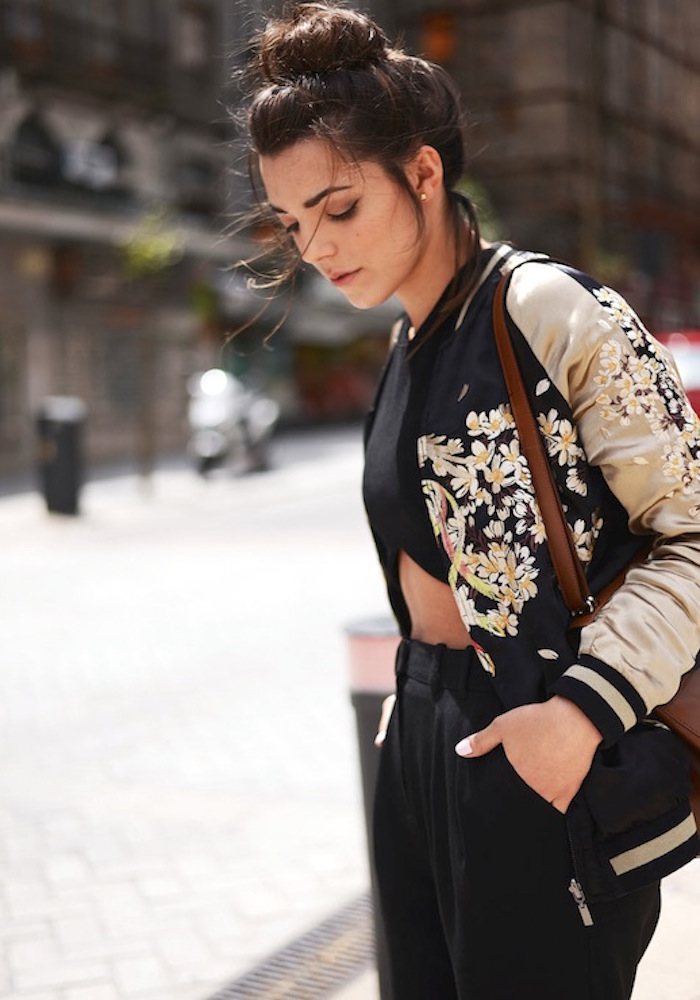 le-fashion-blog-spring-blogger-style-top-knot-embroidered-floral-bomber-jacket-black-crop-top-brown-bag-wide-leg-pants-platform-sandals-via-the-fashion-through-my-eyes