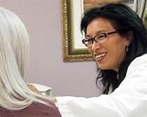 Dr. Pien observing the positive results on a patient's facial scars