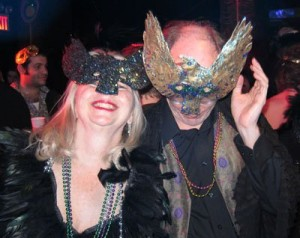 Sheila and Kevin in crow masks at Mardi Gras