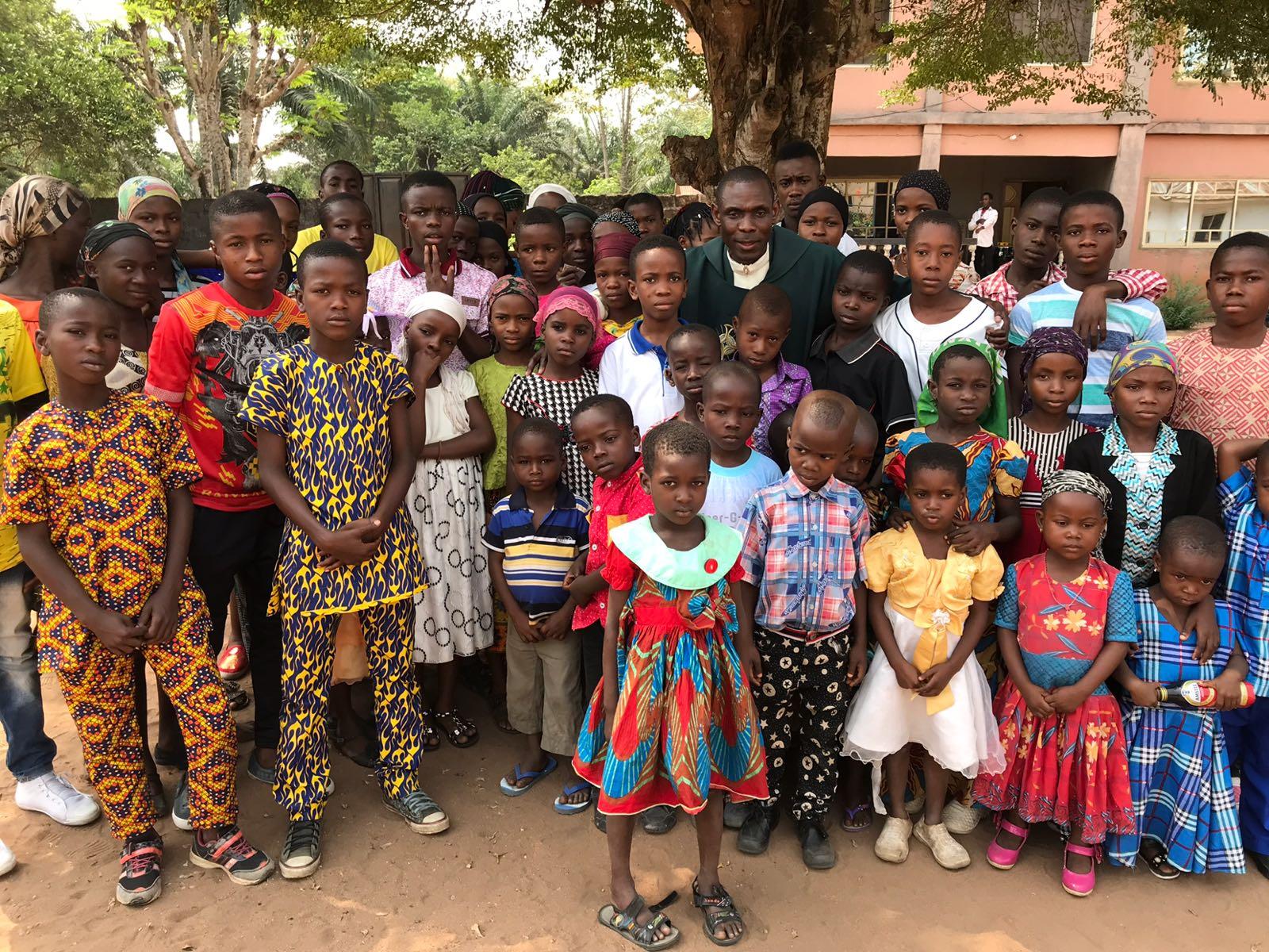 Father Kingsley Ihejirika with DMIWOO orphans