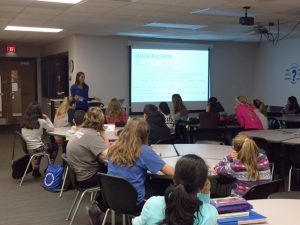 physical therapist discussion at local school