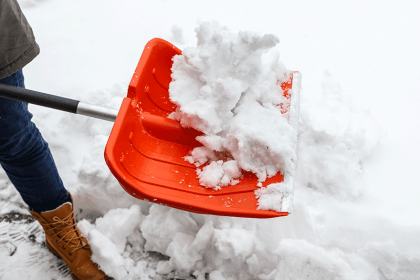 shoveling snow, winter weather, franklin, milwaukee, slippery, icy, slippery roads, weather