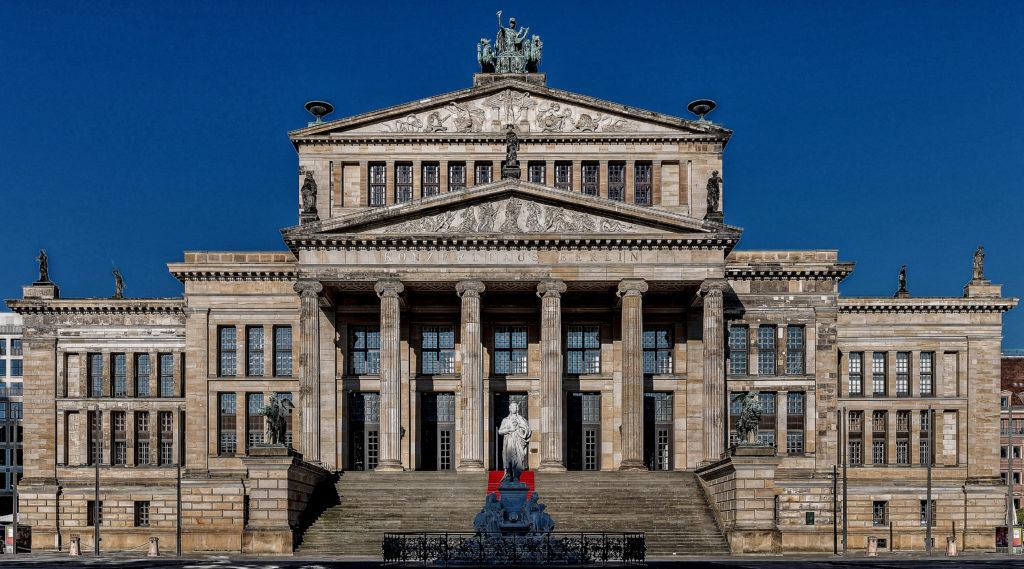 Karl Friedrich Schinkel - Architect, Christian Daniel Rauch and Friedrich Tieck - sculptors, Schauspielhaus Ostgiebel Konzerthaus, concert hall Berlin, Tympanums above the main entrance Sculptures created by Christian Friedrich Tieck about 1820