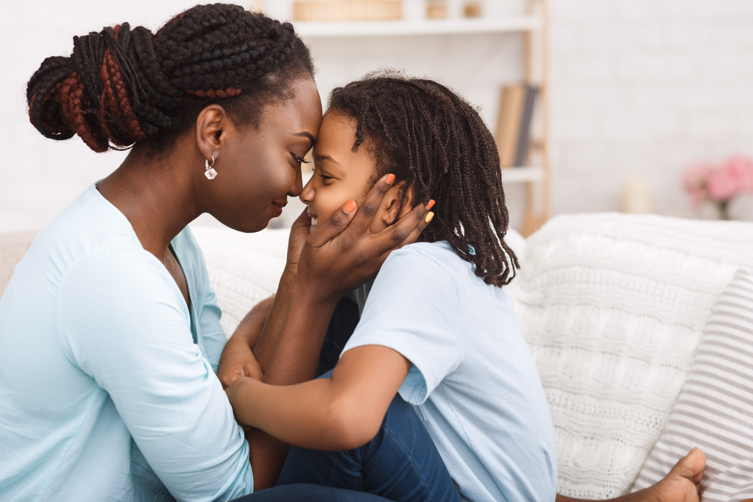 Loving african mom spending time with child