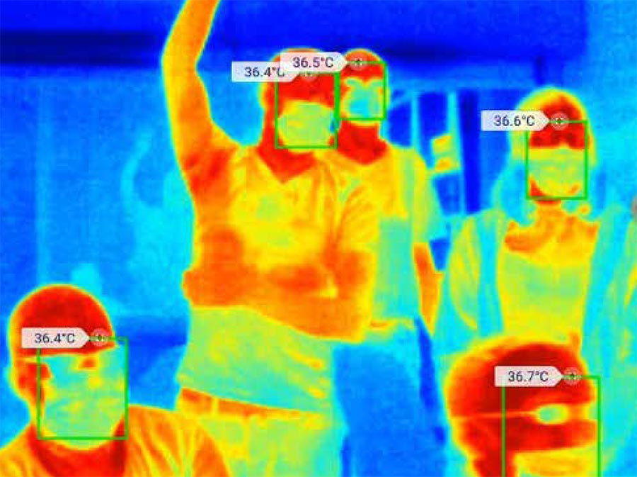 Thermal image of a group of people with their temperatures listed