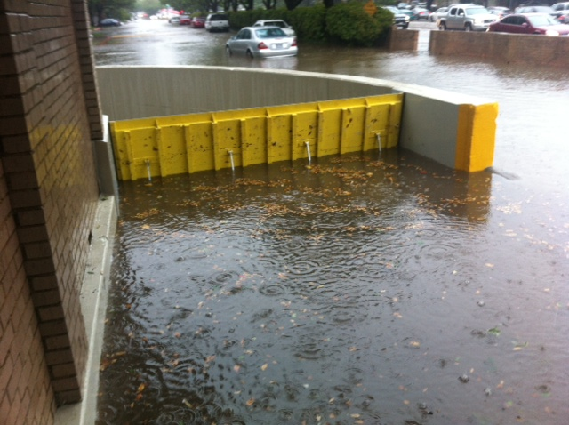 passive automatic flood barriers deploy and save garage from flooding