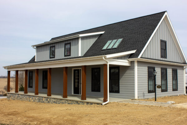 Gray house with white trim and chestnut brown column wraps