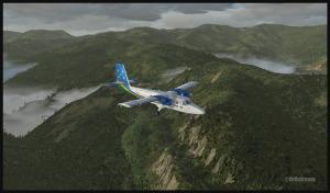 Twin Otter traversant la chaîne de montagnes Owen Stanley, vers l'aéroport de Kokoda