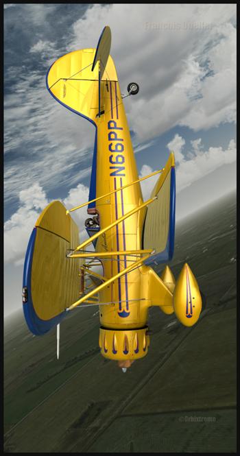 Un WACO YMF5 pratique quelques manoeuvres acrobatiques au-dessus de la région de Airdrie, en Alberta.