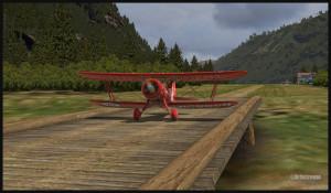 Un avion WACO de la compagnie Texaco circule sur le ponceau de Bear Gulch, WA38