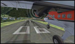 Un avion Twin Otter se pose sur la piste 06 de Lukla