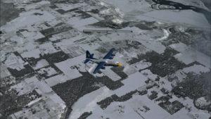 Avion virtuel C-130 Hercules avec trois moteurs en panne, par le travers de la piste de Bonners Ferry.