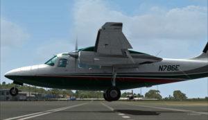 Vue latérale du Shrike Commander 500S en finale pour le hangar à Port Moresby Jacksons.