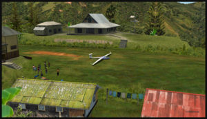 Planeur sur la courte piste en gazon et en pente de Fane Parish en Papouasie Nouvelle-Guinée.