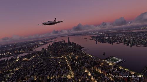 Au-dessus de New York en soirée avec le simulateur de vol Microsoft Flight Simulator 2020.