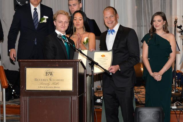 Adam Beres Presenting Ambassadors of the Future Scholarship Award to USC Dean Eddie Sartin
